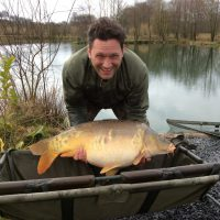 Mirror carp caught at L'angottiere carp fishery offering exclusive carp fishing in france