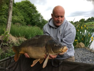Carp capture at L'Angottiere Carp Fishery offering exclusive carp fishing in France. If you are looking for a carp lake or fishing holiday in France please check out www.carpfishingnormandy.com