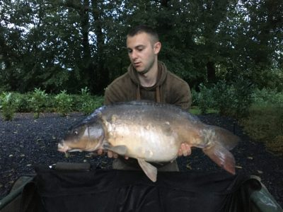 carp capture at L'Angottiere carp fishery in france