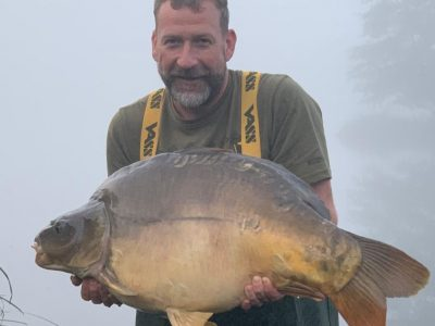 Craig with a large mirror carp from L'Angottiere